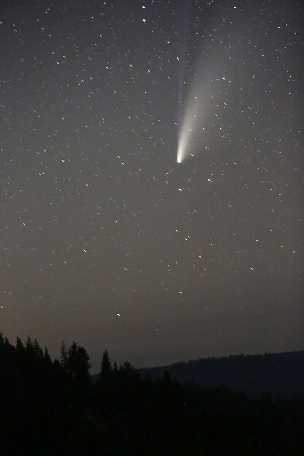 Comet Neowise leaves its cosmic tails of dust and ionized gasses in the night sky as it makes its 6,766 year orbit of the sun as viewed from the Jefferson Creek Scenic Overlook off of Highway 20 July 19. The comet was be closest to Earth on July 23 at 64 million miles away. | Photo: Elias Funez