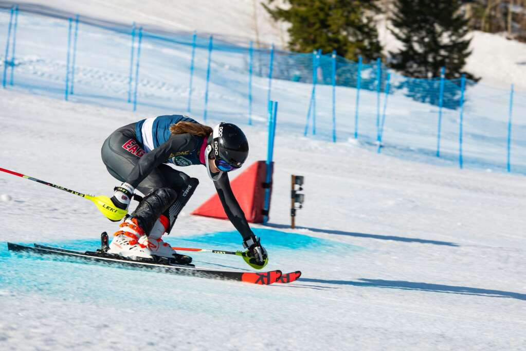 American alpine skier Morgan Ellis reaches across the finish line during her first run of the Women's Alpine Combined National Championship at Aspen Highlands on Wednesday, April 14, 2021. (Kelsey Brunner/The Aspen Times)