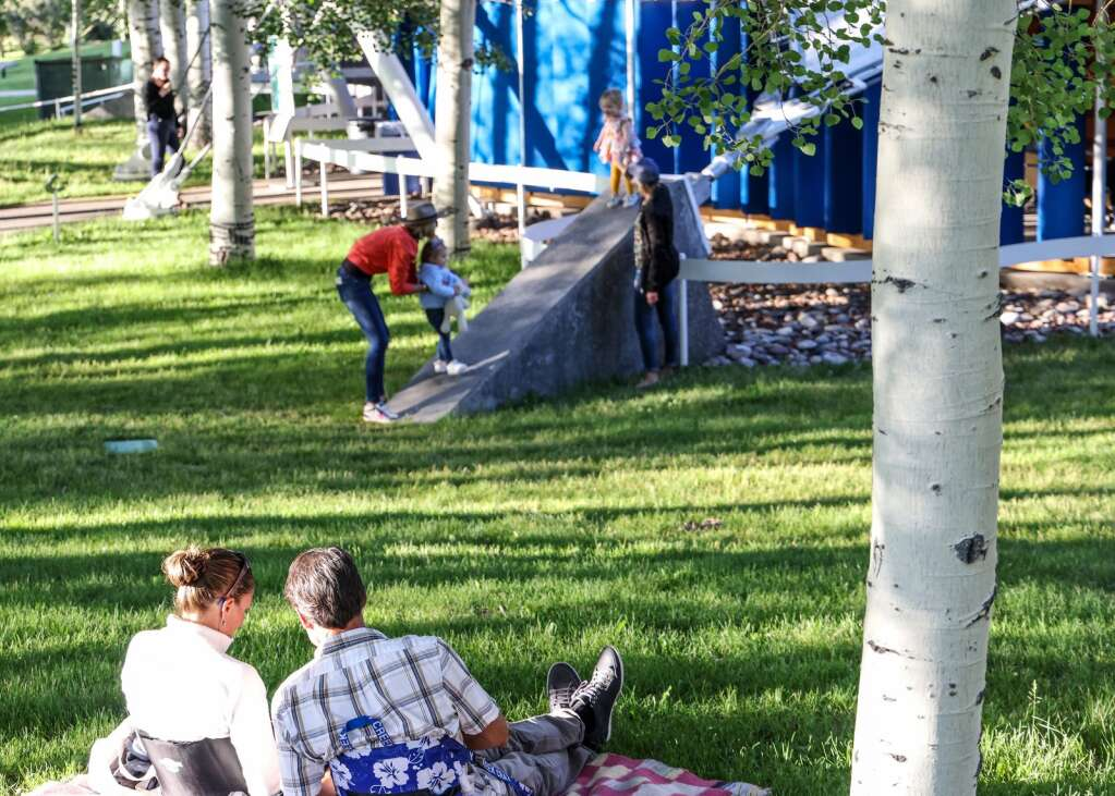 People lounge outside as pianist Matthew Whitaker performs in an Aspen Music Festival and School recital to kickoff the summer season on Thursday, July 1, 2021, inside the Benedict Music Tent in Aspen. Photo by Austin Colbert/The Aspen Times.