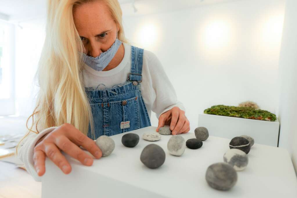 Boulder artist Heather Cherry, seen here setting up her exhibit on Thursday, May 27, 2021, will be the first to occupy the space in the Art Base's new location in downtown Basalt. Photo by Austin Colbert/The Aspen Times.