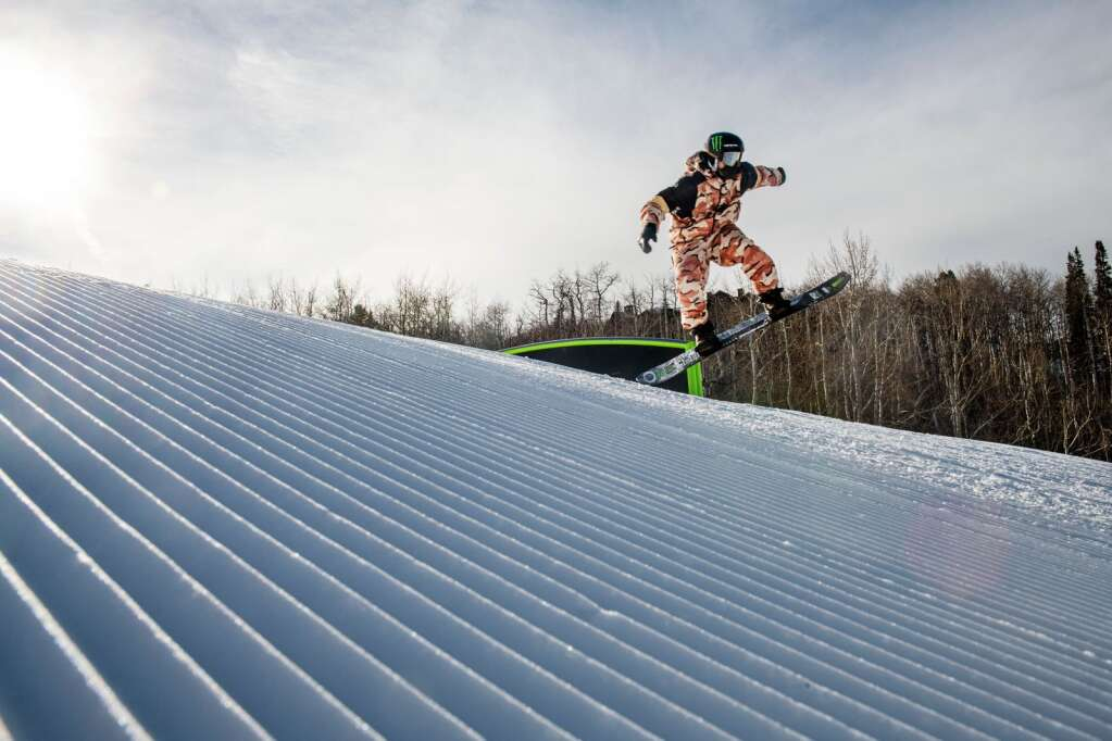Norwegian snowboarder Ståle Sandbech hits a rail on the top of the slopestyle course during a practice session in the afternoon during the 2021 X Games Aspen at Buttermilk on Thursday, Jan. 28, 2021. (Kelsey Brunner/The Aspen Times)