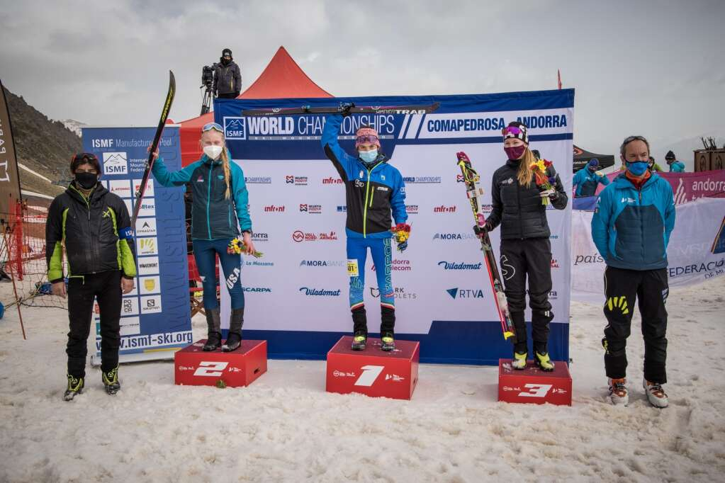 Summit County's Grace Staberg, left, her friend gold medalist Samantha Bertolina of Italy, center, and bronze medalist Caroline Ulrich of Switzerland celebrate on the podium at the end of the International Ski Mountaineering Federation vertical U-20 women's world championship race in Andorra on Thursday, March 4. | Photo by SkiMoStats.com