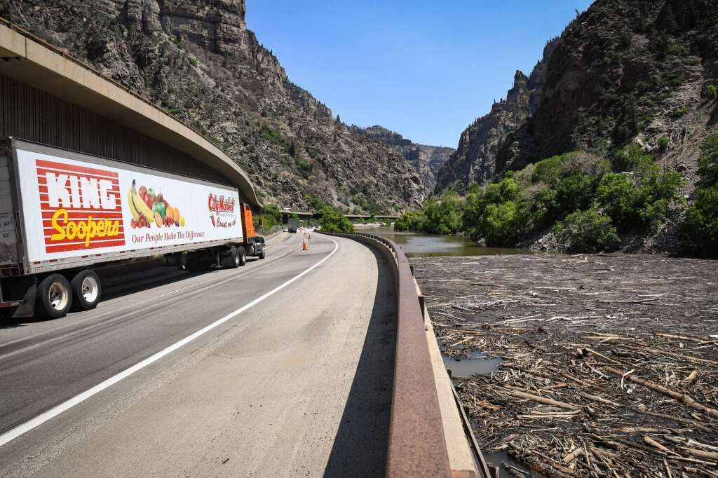 Traffic continues through Glenwood Canyon as logs and debris sit in the Colorado River near MM124 in Glenwood Canyon after last Thursday's storm washed a debris slide down the Devil's Hole drainage partially damming the river. |Chelsea Self / Post Independent