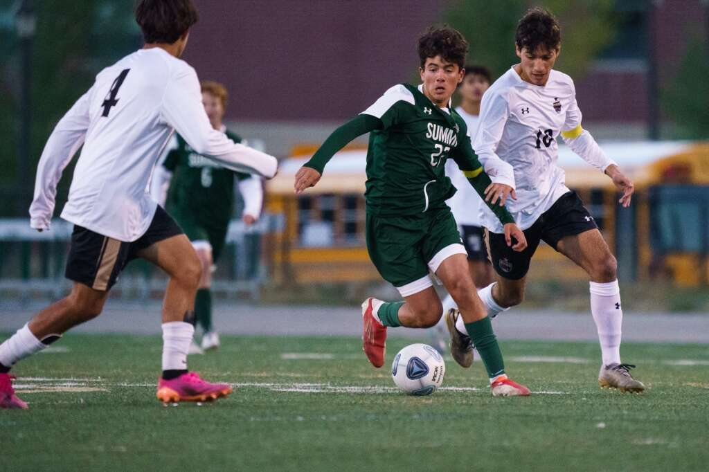 Owen Gallo fights off two defenders early in the second half during the Summit Tigers homecoming match against Battle Mountain on Tuesday, Sept. 21, at Tiger Stadium in Breckenridge. | John Hanson/For the Summit Daily News
