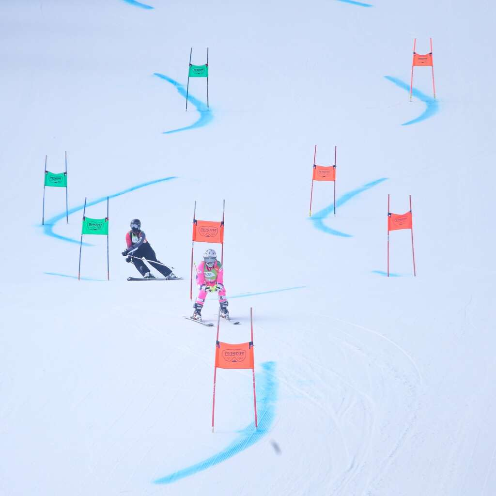 Skiers Lauren Jackson, of Carbondale (left) races Lynn Wise, of York, South Carolina, in the Bronze division head-to-head finals at NASTAR national championships on April 7, 2021, at Snowmass Ski Area. | Austin Colbert/The Aspen Times
