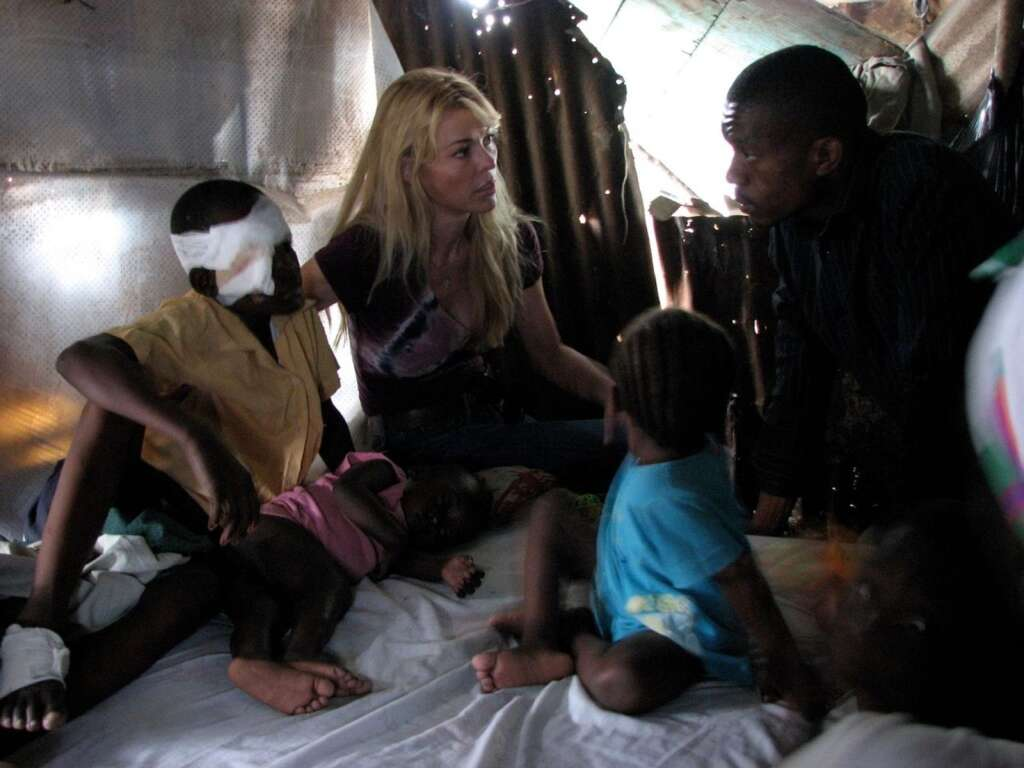 Susie Krabacher visiting school students injured in the 2010 earthquake.