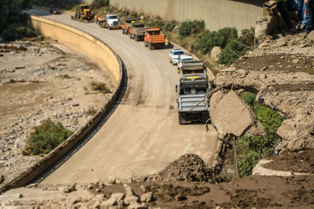 Colorado Department of Transportation trucks wait to be filled up with rock and mud Wednesday in Glenwood Canyon.   Chris Dillmann/cdillmann@vaildaily.com