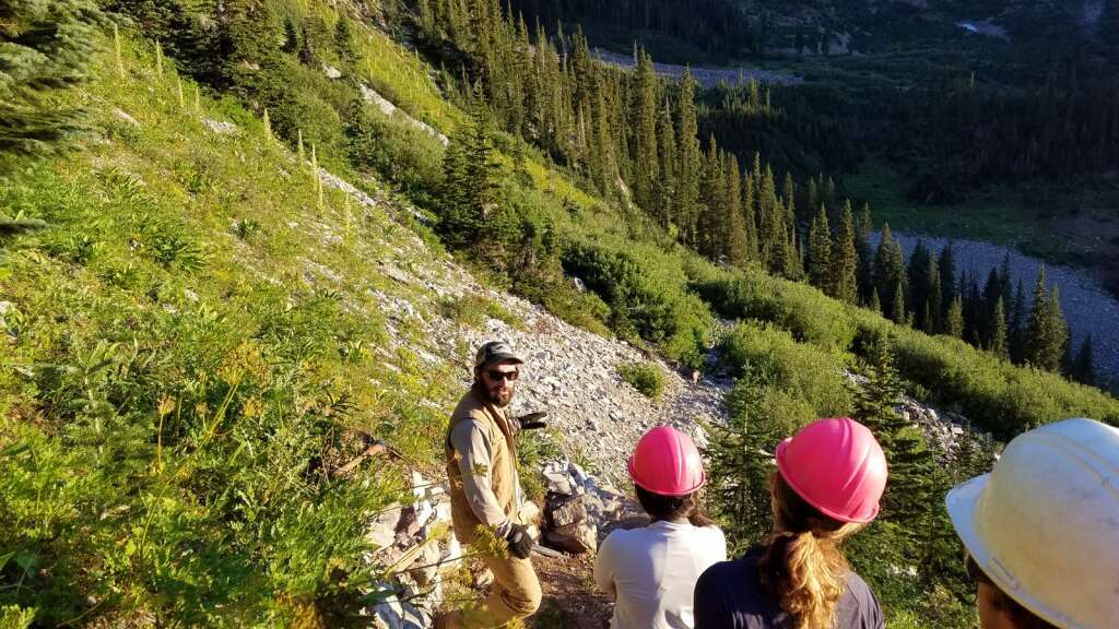 A CFI crew leader instructs volunteers in summer 2019 about the work needed on a section of trail on North Maroon Peak. | CFI\courtesy photo