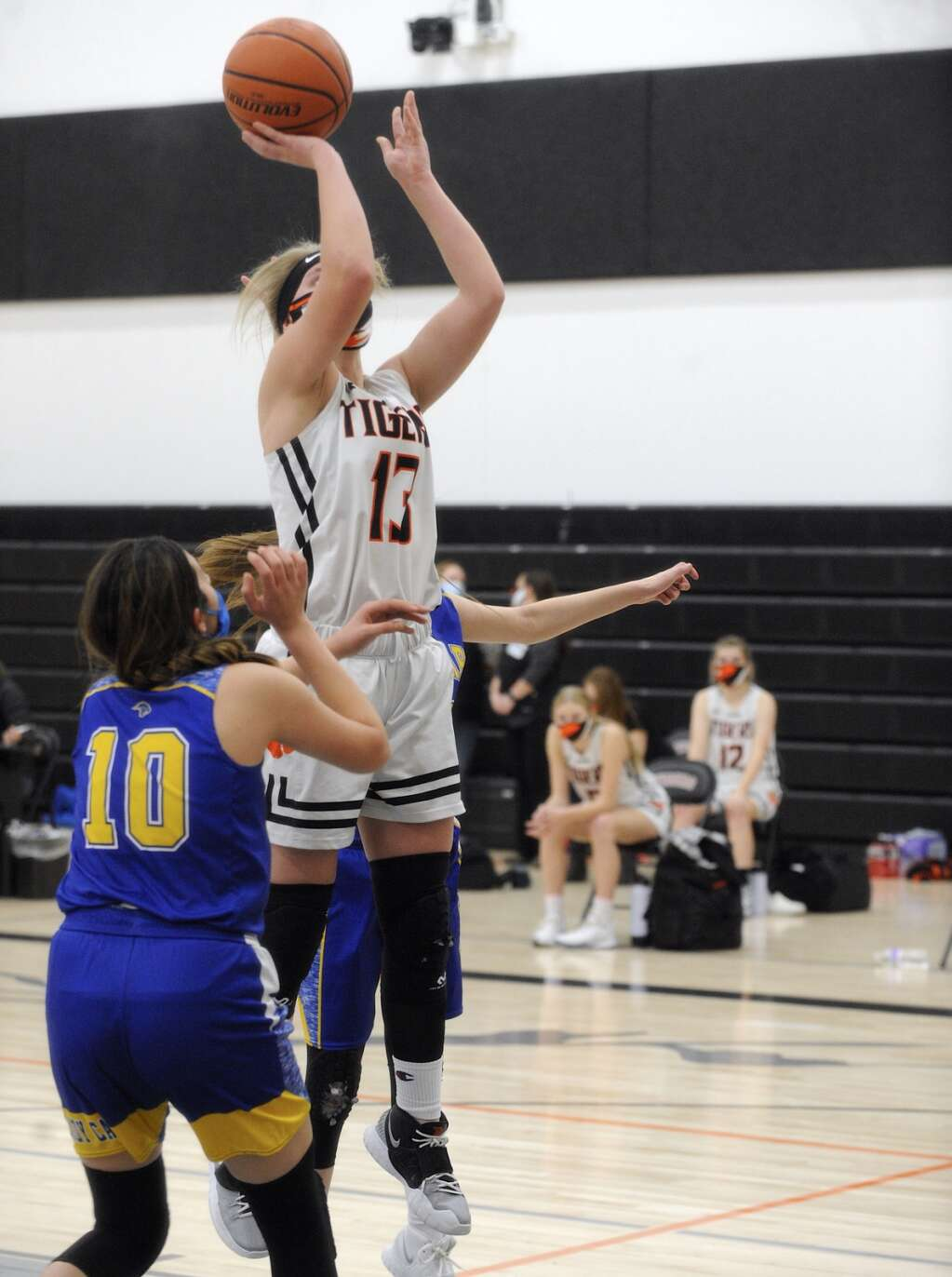 Hayden junior Alison Rajzer puts away a rebound during a game against North Park on Friday evening. (Photo by Shelby Reardon)