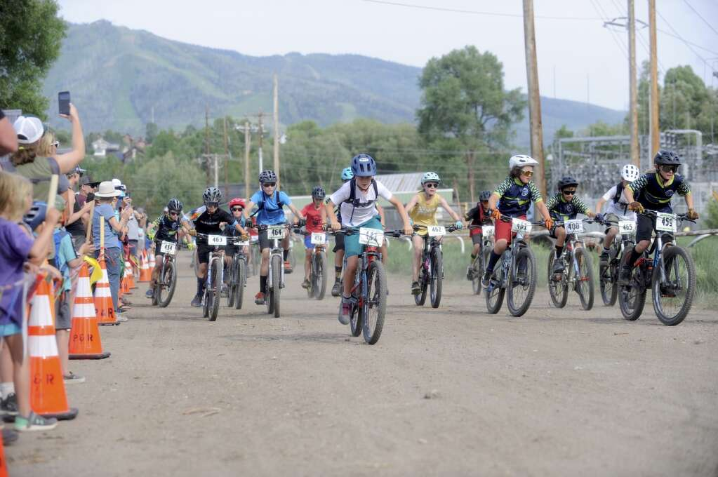 The kids 11-12 race takes off at the Town Challenge Emerald Endurance race on Wednesday evening. (Photo by Shelby Reardon)