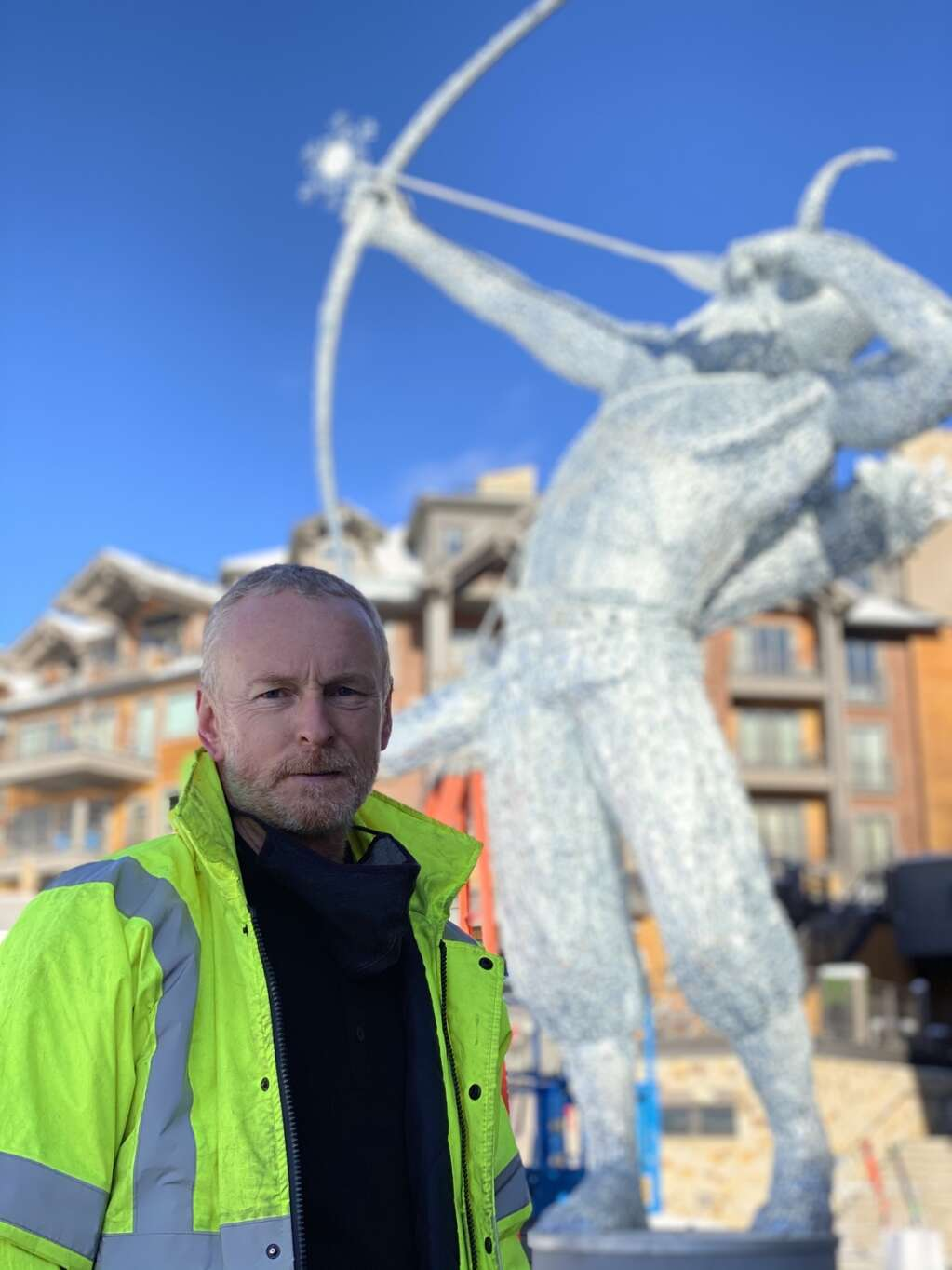 Sculptor Andy Scott stands in front of his sculpture of Ullr on Nov. 11, the day it was installed in Breckenridge. | Photo by Juli Rathke /Breckenridge Grand Vacations