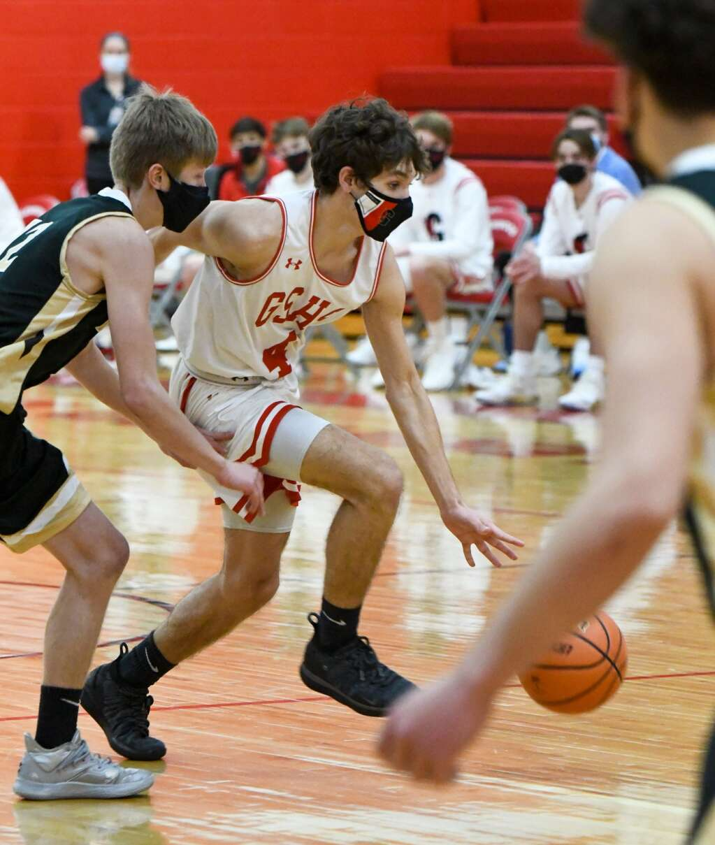 Glenwood Springs Demon Aiden Nieslanik dribbles the ball around the defending Battle Mountain Husky during Thursday night's home game. |Chelsea Self / Post Independent