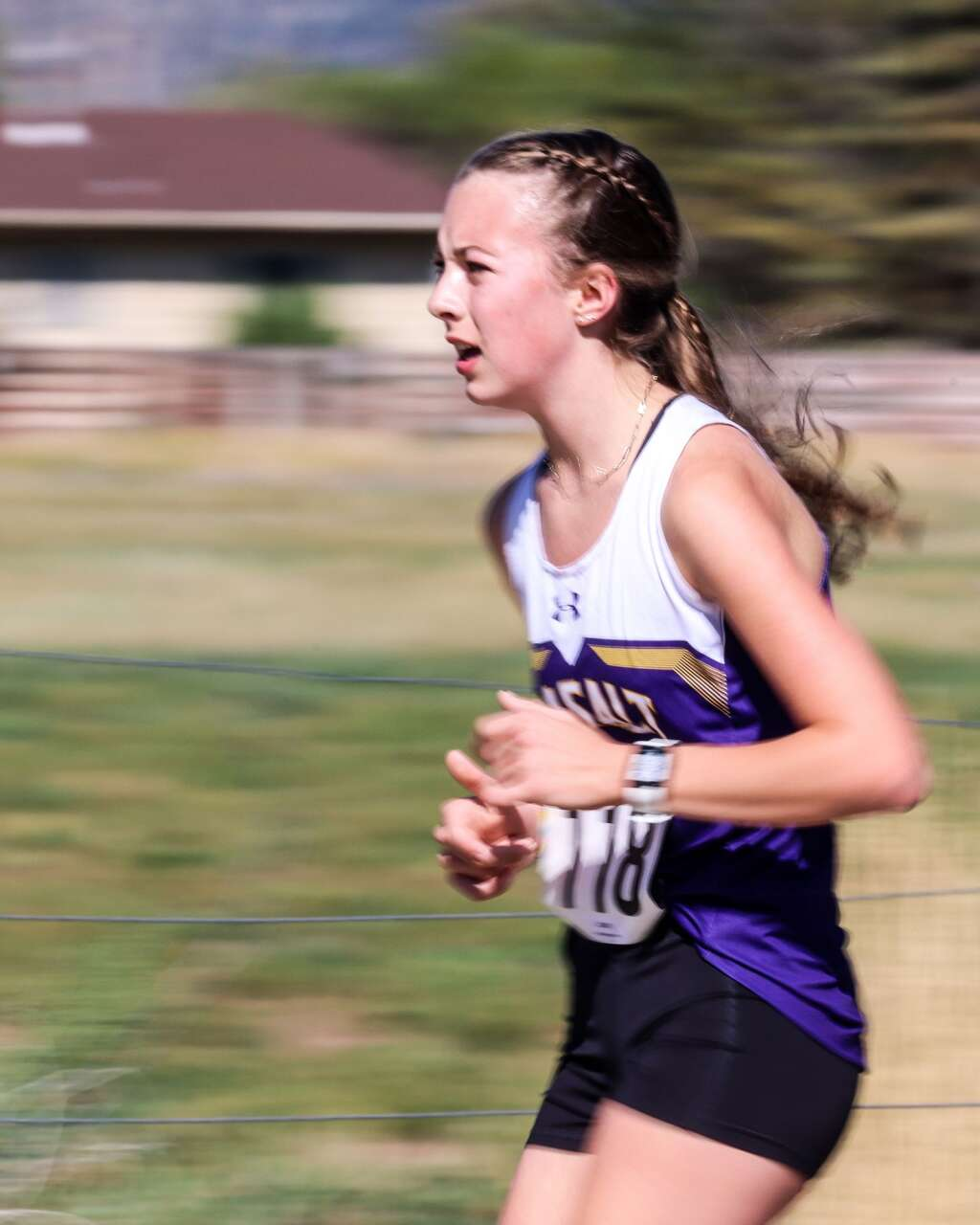 A Basalt runner competes in the Longhorn Invitational cross country meet on Saturday, Aug. 28, 2021, at Crown Mountain Park in El Jebel. Photo by Austin Colbert/The Aspen Times.