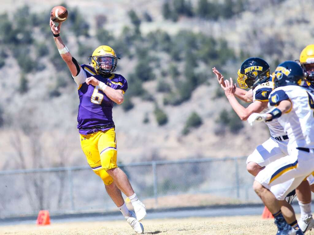 Basalt High School quarterback Matty Gillis throws against Rifle on Saturday, April 3, 2021, on the BHS field. The Longhorns won, 38-7. Photo by Austin Colbert/The Aspen Times.