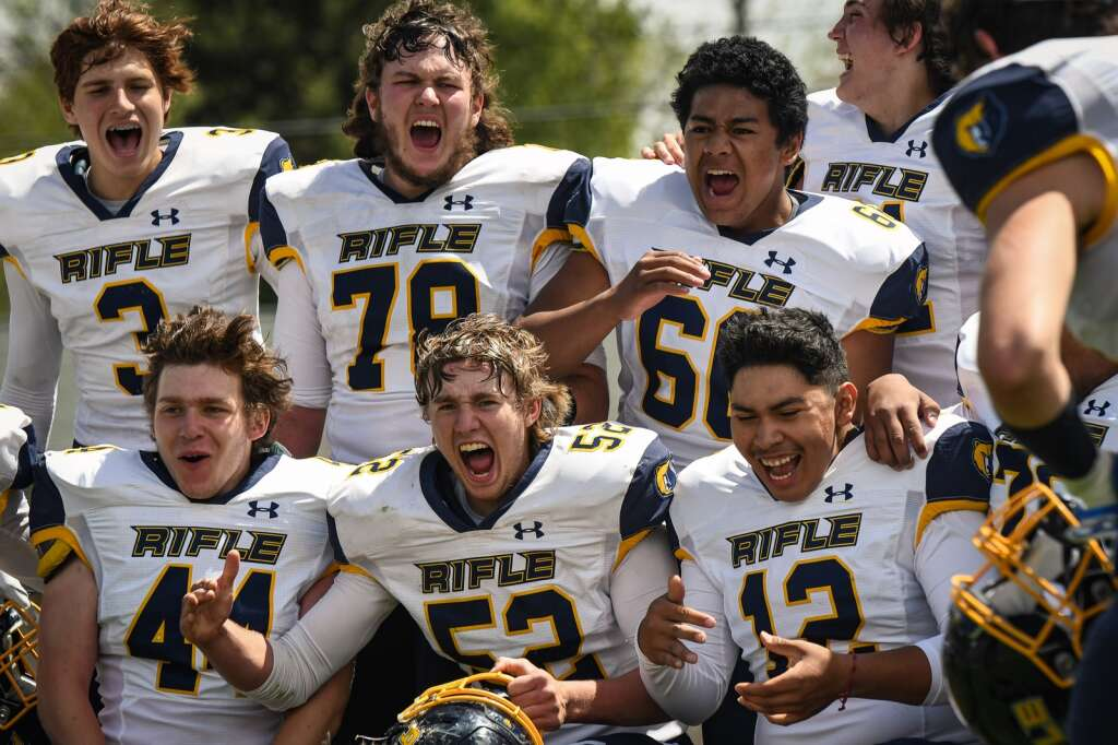 The Rifle Bears celebrate after defeating the Glenwood Springs Demons during Saturday's state semi-final game at Stubler Memorial Field. |Chelsea Self / Post Independent