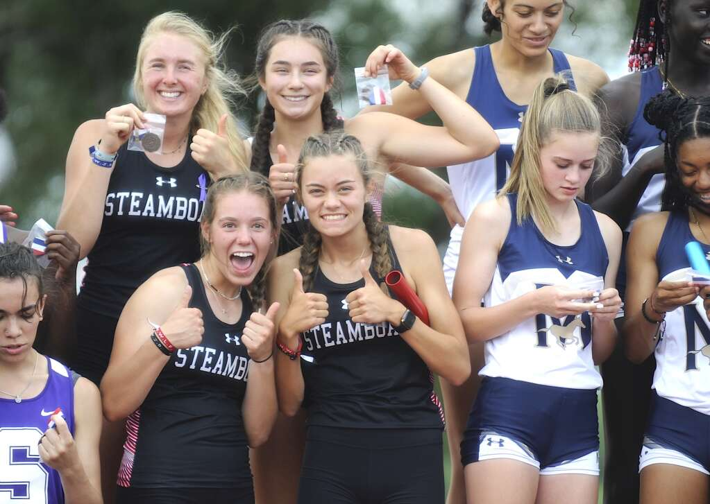 The Steamboat Springs girls 4x200 team of Marcada Baker, Aliyah Reimer, Elise Colby and Kelsey Hamilton were proud of their fourth-place finish at the CHSAA Track and Field State Championships at JeffCo Stadium on Friday. (Photo by Shelby Reardon)
