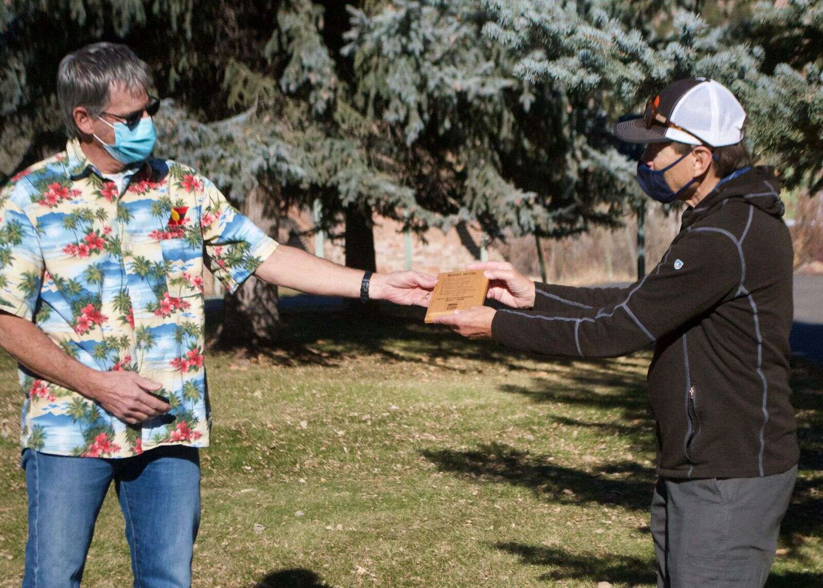 Michael Hutton (left) is congratulated by Roaring Fork Outdoor Volunteers executive director Ron Rash for being a founder of the organization.| Courtesy photo