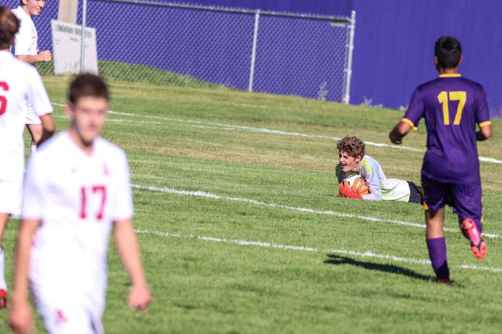 Aspen High School goalie Emilio Adams holds on to the ball against Basalt on Wednesday, Sept. 15, 2021, on the BHS field. | Photo by Austin Colbert/The Aspen Times
