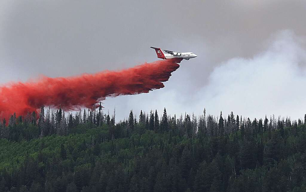An airtanker drops fire retardant on the Muddy Slide Fire on June 23 as crews continue to battle the blaze with air power just east of Yampa. This plane was seen making a run at the fire from Gore Pass. (Photo by John F. Russell)