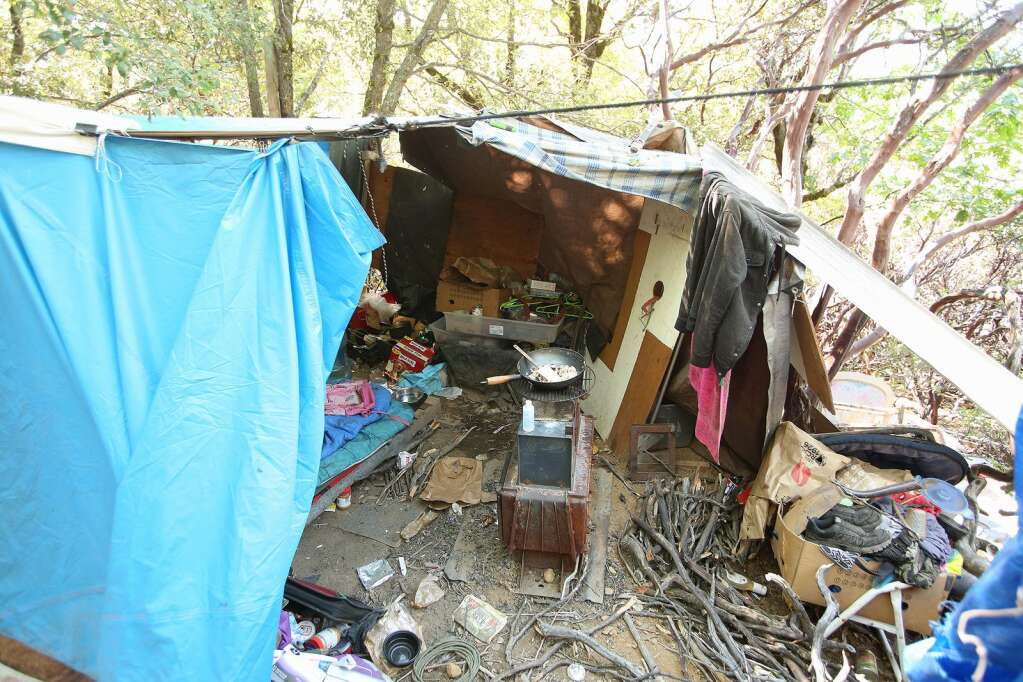 A homeless encampment on Sugarloaf Mountain is revealed after climbing through a maze of trails through thick brush. Nevada County initially opted for some area homeless, such as those on Sugarloaf, to shelter in place during the pandemic. Now, county officials are doing their best to get roofs over the heads of Sugarloaf homeless. | Photo: Elias Funez