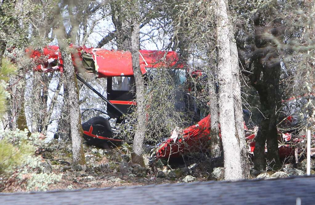 The mangled wings, fuselage, and landing gear of a single engine airplane lies scattered among a grove of oak trees near Dry Creek Road and Haines Road near the city of Auburn's municipal airport Jan. 24. Two of the three occupants died as a result of the wreck. | Photo: Elias Funez
