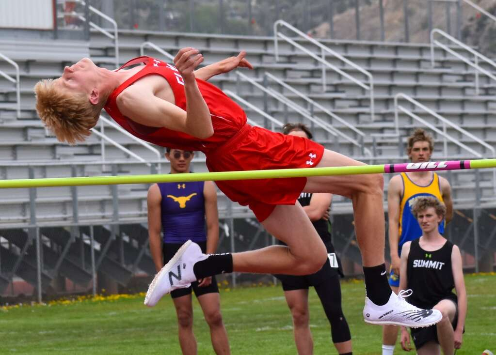 Glenwood junior Reid Swanson clears the bar en route to his win in the the high jump event Saturday.| John Stroud/Post Independent