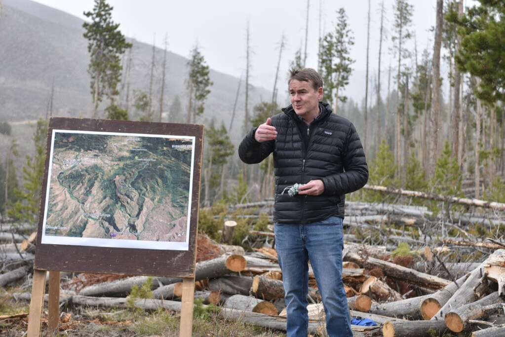 Bennet speaks to US Forest Service officials about how he can support their work managing lands and protecting watersheds at the Blue Ridge Prescribed Burn site outside Hot Sulphur Springs. | McKenna Harford/mharford@skyhinews.com