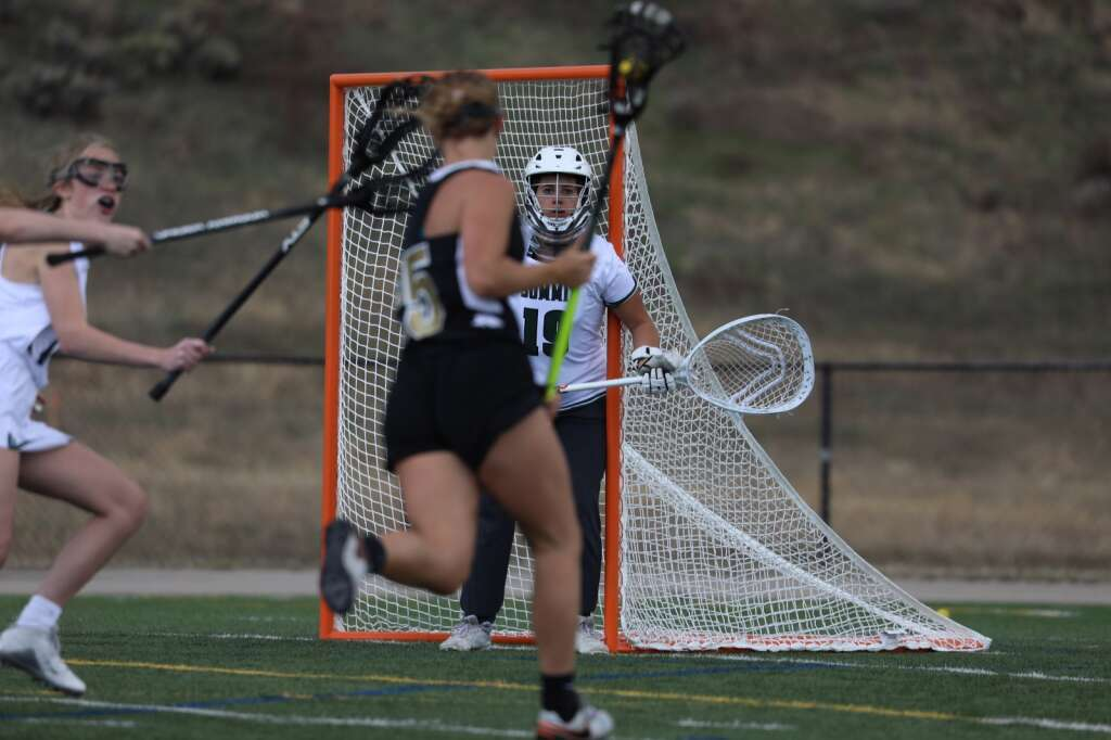 Summit High School senior goaltender Sydney Mullins defends the net against Battle Mountain during the Tigers girls varsity lacrosse team's season opener vs. Battle Mountain on May 8 at Tiger Stadium in Breckenridge. | Photo by Ashley Low / Ashley Low Photography