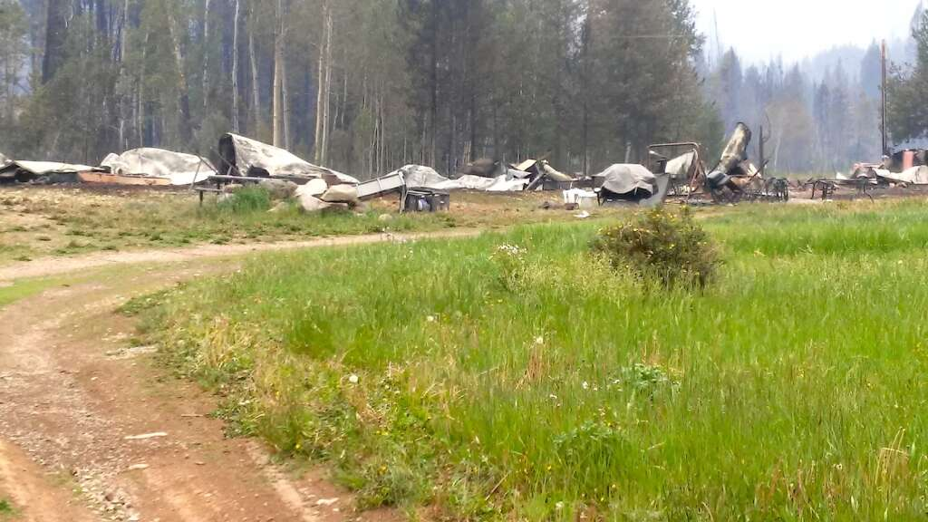 When the Muddy Slide Fire grew on June 22 afternoon, Jim Ficke had a feeling his property on Lynx Pass was in danger. All seven trailers on the property, a small cabin and some outbuildings are now a total loss. (Courtesy/Barb Ficke)