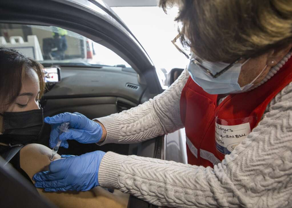 RN Judy Rogers administers the Moderna vaccine to a patient at a drive-through location at the Utah Film Studios Friday afternoon, Jan. 22, 2021. (Tanzi Propst/Park Record)
