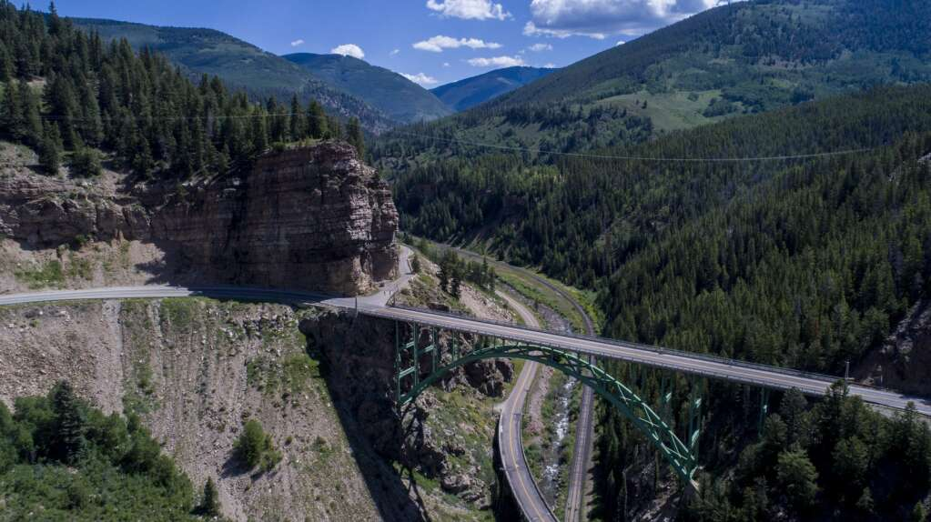Cyclists ride over the Red Cliff bridge during a previous edition of the Copper Triangle road cycling event. | Photo by Justin Balog / Copper Triangle