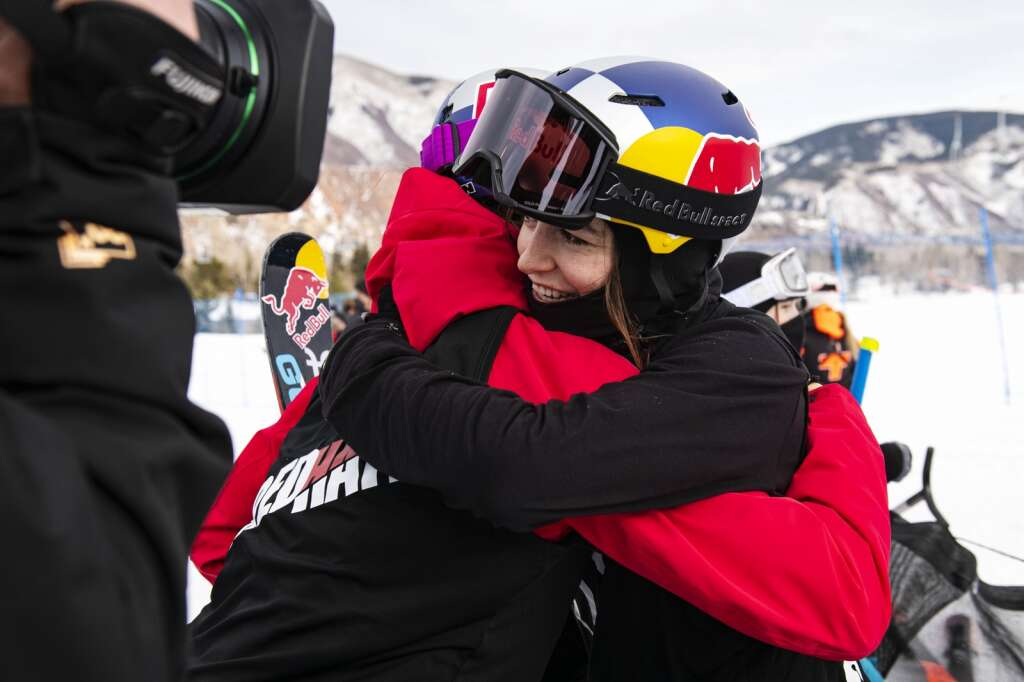 Swiss freestyle skier Mathilde Gremaud hugs Eileen Gu after successfully completing a switch double cork 1440 1440 during the Big Air competition that won her the gold medal at the 2021 X Games Aspen at Buttermilk on Friday, Jan. 29, 2021. Gremaud landed the first switch double cork 1440 in history during a womens big air competition. (Kelsey Brunner/The Aspen Times)