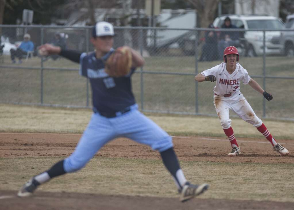 Park City's Braxton Lyon (32) leads off of first base as Salem Hills pitches during their matchup Monday afternoon, April 5, 2021. The Miners fell to the Skyhawks 7-2. (Tanzi Propst/Park Record)