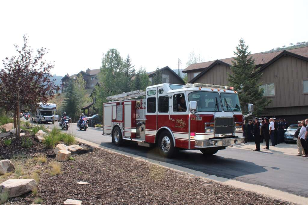 Members of the Salt Lake City Fire Department, Park City Police Department and Summit County Sheriff's Office joined the Park City Fire District on Sunday in escorting fallen fire chief Paul Hewitt's family from Salt Lake City to their home, where an honor guard met them.   Courtesy of the Park City Fire District