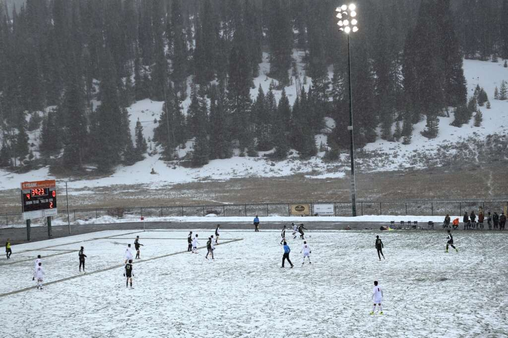 The Summit High School varsity boys soccer teams battles against the Glenwood Springs Demons during a snowy senior night match at Climax Molybdenum Field at Tiger Stadium on April 15, 2021. The Tigers defeated the Demons 4-0. | Photo by Jason Connolly / Jason Connolly Photography