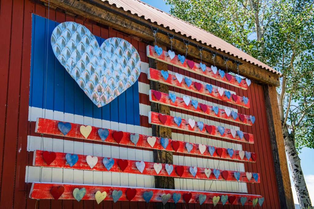 John Przonek's 3D mural of an American Flag is displayed on the back of the RFTA bus stop at Lions Park behind the Basalt Town Hall on Wednesday, June 9, 2021. (Kelsey Brunner/The Aspen Times)
