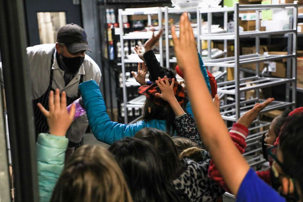Meat Department Manager, Jason Steiner, engages with first-graders from Edwards Elementary School Monday in Edwards. The students toured each department and learned what it takes to run one.