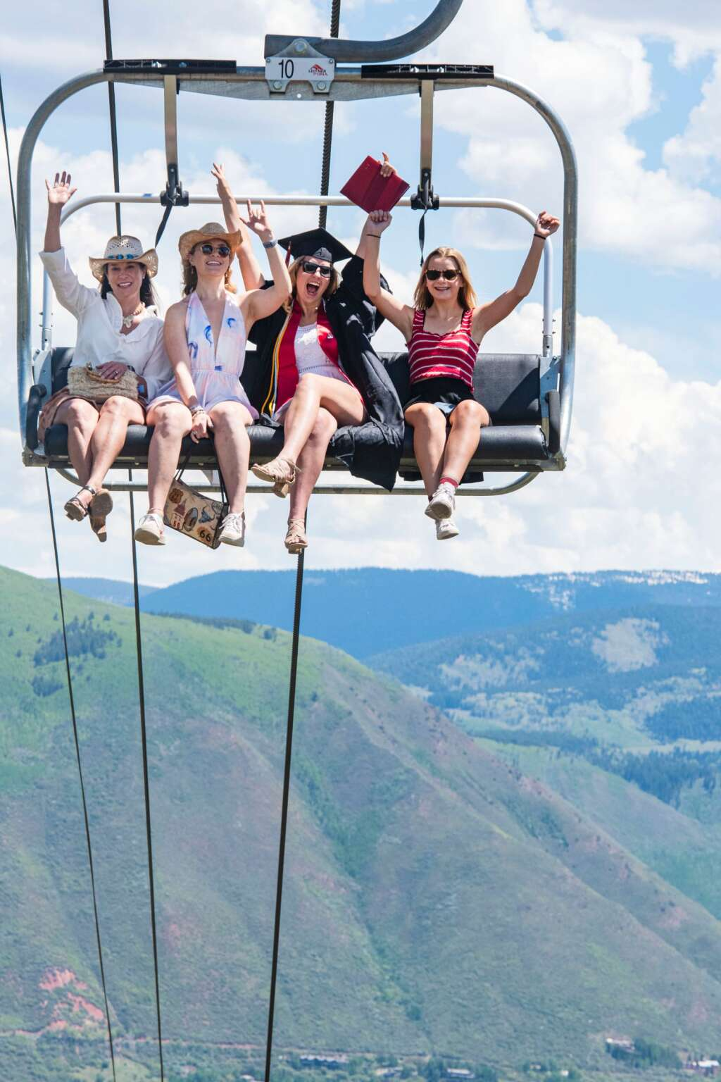 An Aspen High School graduate and her family ride the Tiehack Life to the top of Buttermilk after the 2021 commencement ceremony at the school in Aspen on Saturday, June 5, 2021. (Kelsey Brunner/The Aspen Times)