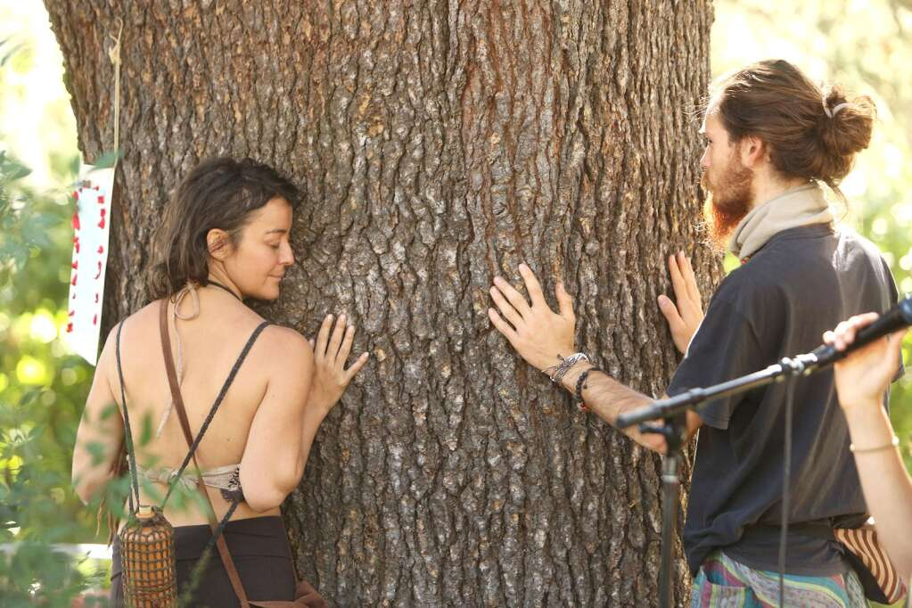 Tess Athena and Iskandar Sexto pay their respects to the 160 year old Blue Atlas Cedar at the corner of Broad and Bennett Street in Nevada City Oct. 21. | Photo: Elias Funez