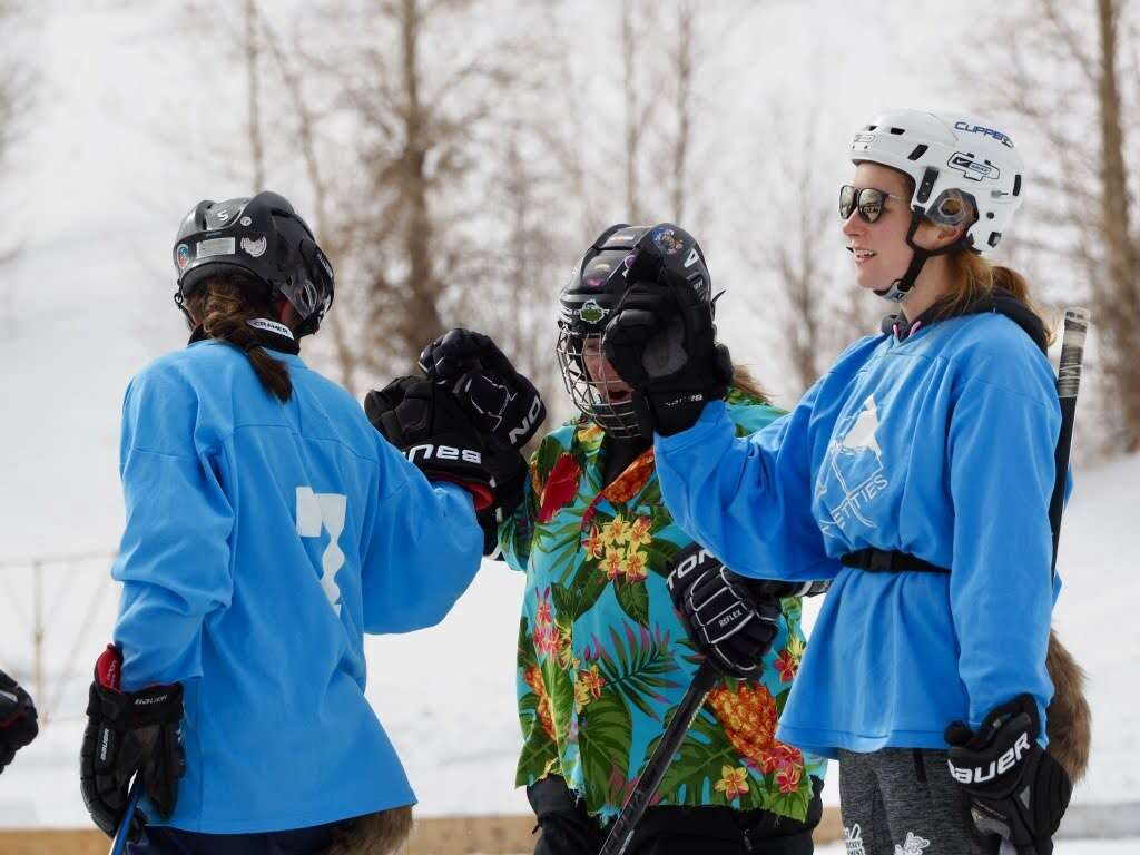 Members of the Pucking Critters women's championship pond hockey team celebrate a goal during last weekend's Pabst Blue Ribbon Colorado Pond Hockey Tournament at North Pond Park in Silverthorne. | Photo by Elaine Collins