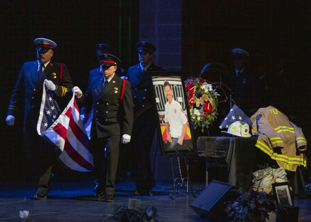 Firefighters present the flag during a memorial service for late Park City Fire Chief Paul Hewitt Thursday evening at the Eccles Center. Department members folded the flag and presented it to Kelly Trang, Hewitt's fiancée. |(Tanzi Propst/Park Record)