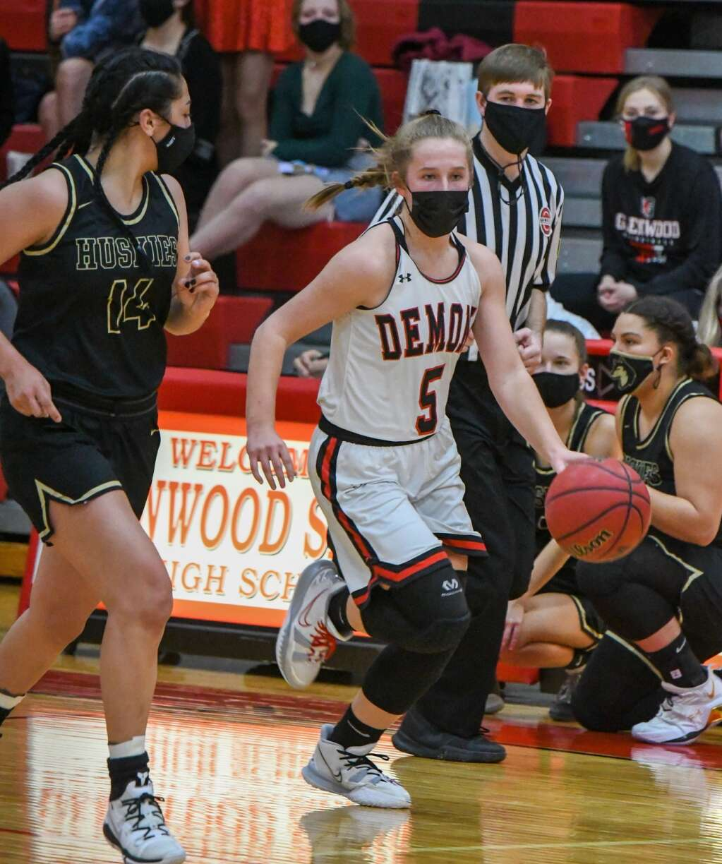 Glenwood Springs Demon Kenzie Winder dribbles the ball around the defending Battle Mountain Husky during Thursday night's game at Glenwood Springs High School. | Chelsea Self / Post Independent