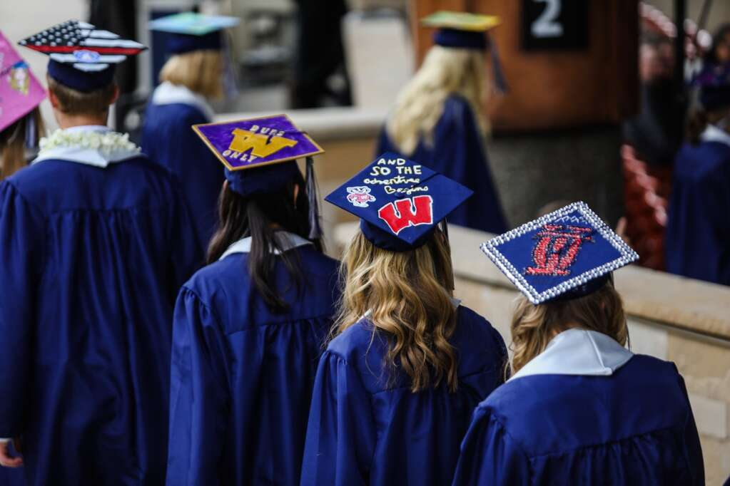 Graduates of the Vail Christian Class of 2021 make their way to the stage with decorated caps during the commencement ceremony Sunday in Vail. Twenty five students graduated in the Class of 2021 for Vail Christian.    Chris Dillmann/cdillmann@vaildaily.com