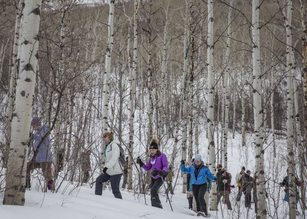 A snowshoe tour hikes on the McPolin Farm trail during an educational tour Friday afternoon, Feb. 26, 2021. (Tanzi Propst/Park Record)