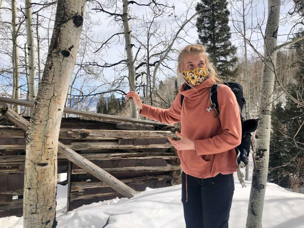 Aspen Center for Environmental Studies naturalist Nicole Goodman shares a piece of human history at an old ranching cabin near the Nature Trail in Snowmass Village during a guided trek on March 9, 2021. | Kaya Williams/The Snowmass Sun