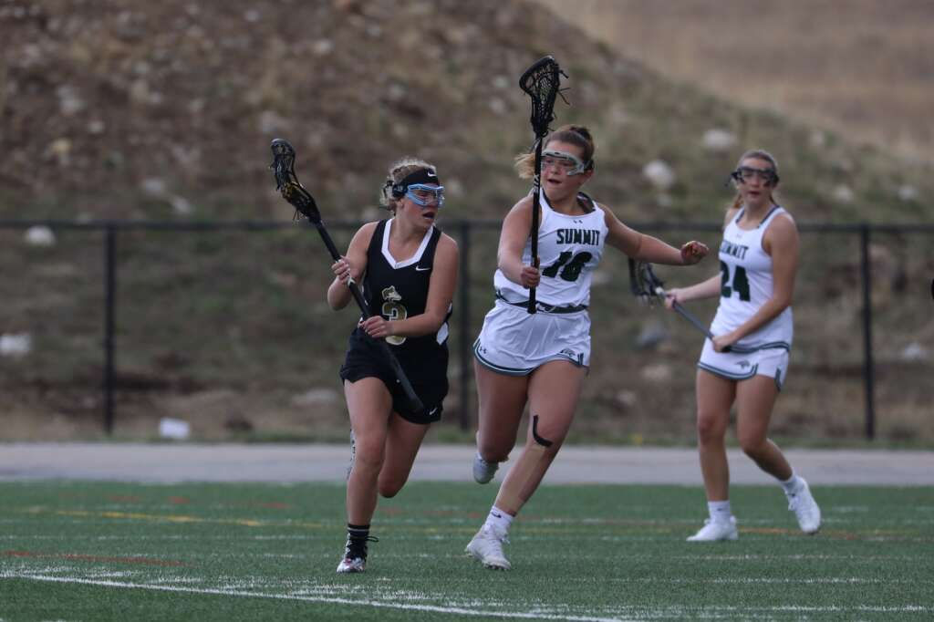 Summit High School sophomore Lindsay Davis defends against Battle Mountain during the Tigers girls varsity lacrosse team's season opener vs. Battle Mountain on May 8 at Tiger Stadium in Breckenridge. | Photo by Ashley Low / Ashley Low Photography