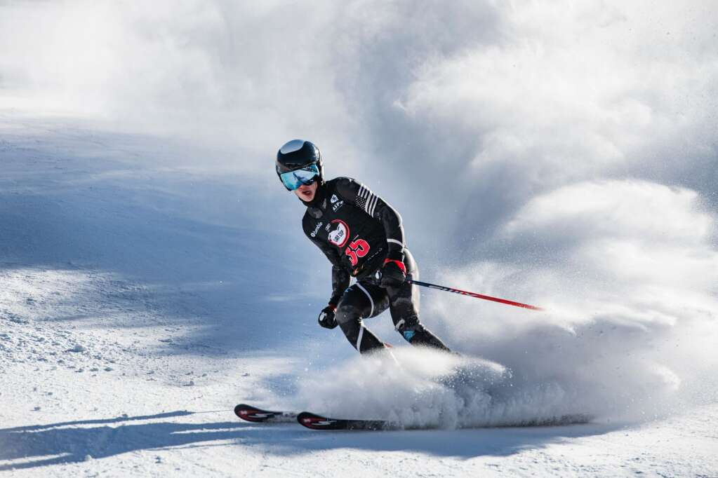 Chase Kelly slows to a stop at the bottom of Stapleton Training Center after a run during the Ajax Cup at Aspen Highlands on Wednesday, Dec. 30, 2020. (Kelsey Brunner/The Aspen Times)