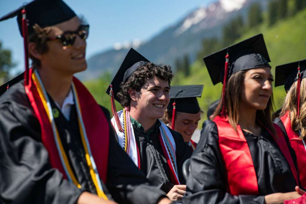 Aspen High School's head boy Jeremy Martin laughs along with his classmates to the valedictorian speech during the commencement ceremony on Saturday, June 5, 2021. (Kelsey Brunner/The Aspen Times)