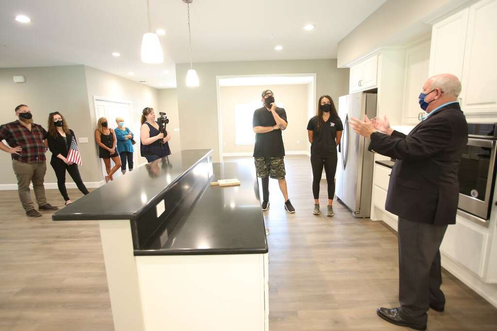 Staff Sgt. Cody Rice is shown his new adaptive home in Penn Valley, given to him through the Homes for Our Troops program. | Photo: Elias Funez