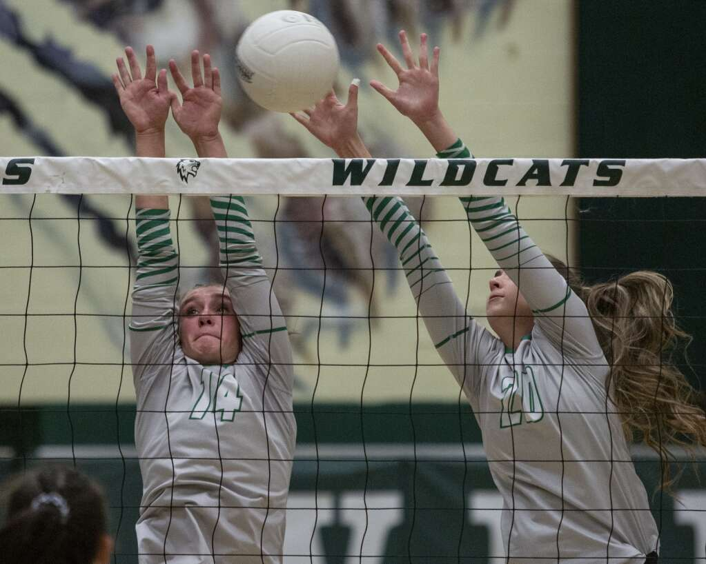 South Summit High School sophomore Devree Gines (14) and junior Addie Williams (20) jump up to the net to block a spike from Layton Christian Academy during their matchup Thursday evening, Sept. 16, 2021. The Wildcats fell to the Eagles 3-2. (Tanzi Propst/Park Record)